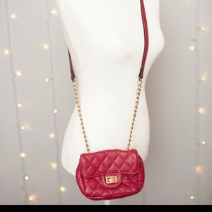Pink crossbody purse with chain strap